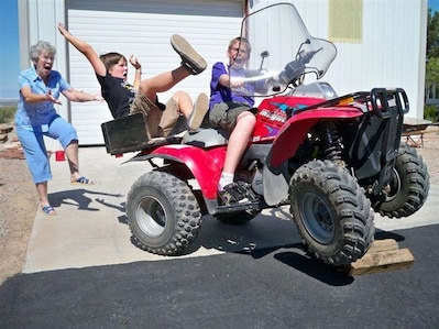 Gran shows off her drop kicking skills by booting young Sean straight onto the back of the quad bike.