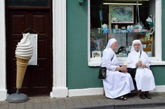 After their ice creams, the ladies rearrange their hoods and go about their daily duties as members of the Ku Klux Klan